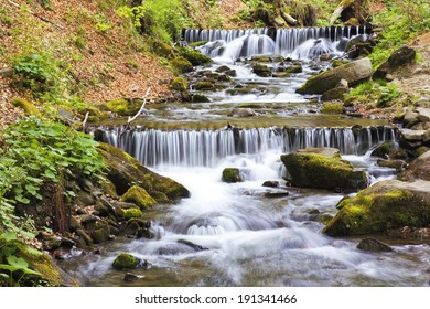 Rapid mountain river in the Ukrainian Carpathians with rapids and waterfalls