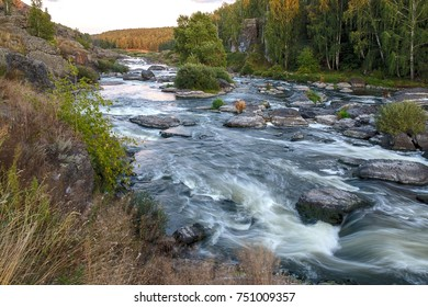 rapid river runs over the rocks among the woods, tourism in Russia