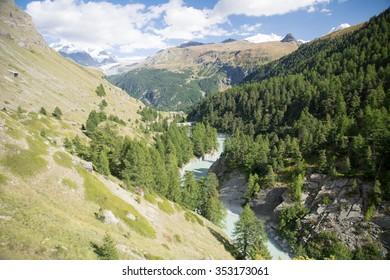 Rapid river in the swiss valley, Zermatt