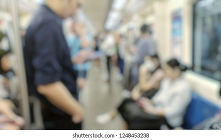 blurred photo of man use mobile Phone on mass rapid train.blurred photo of people on train.
