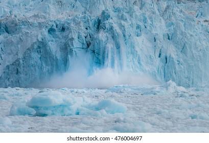 Rapidly calving Eqi glacier, huge icebergs are constantly formed, Disko Bay, Greenland