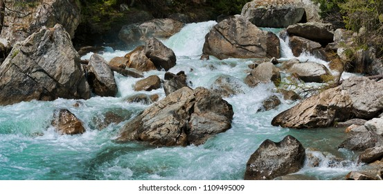 the rapids of the river that flows between the rocks during the melting snow