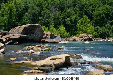 Rappahannock River near Fredericksburg, Virginia. The river has a small riffle zone where it flows past large boulders here.