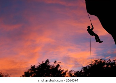 Rappeling at dusk in Montana.