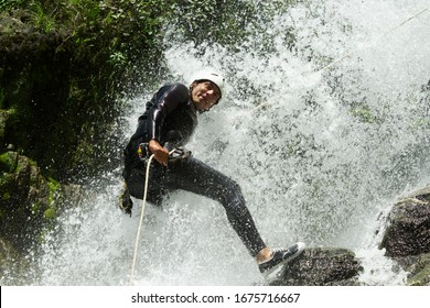 rappeling waterfall wet guide extreme canyoning guide trying out a new course in chama waterfall banos de agua santa ecuador rappeling waterfall wet guide extreme race courage canyon rappel emotion wa