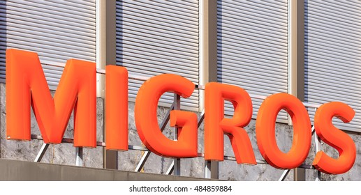 Rapperswil, Switzerland - 12 September, 2016: Migros sign above the entrance of a Migros store. Migros is Switzerland's largest retail company, its largest supermarket chain and the largest employer.
