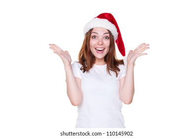 rapturous young woman in santa hat over white background