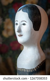 Rare 19th century French hat display head used in Millinery shops in France in the 1800s; made with paper mache and frugally decorated these were not prized items of their time so few remain today