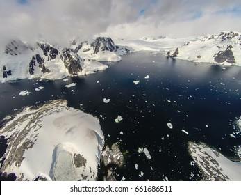 Rare aerial footage around Pleneau Island, Antarctica. Really high above ground.
