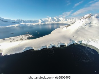 Rare aerial footage of Port Lockroy area, Antarctica. Really high above ground. Unbelievable beauty of nature.
