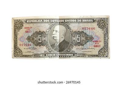 Rare Brazilian cruzeiro real bills isolated on white.