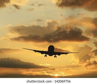 Rare colorful sky at sunset and airplane taking off