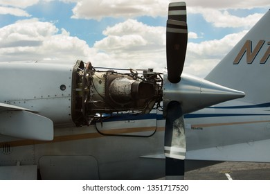 Rare depiction of a turbo prop jet engine mounted on the rear side of the wing. Invites Motivation.