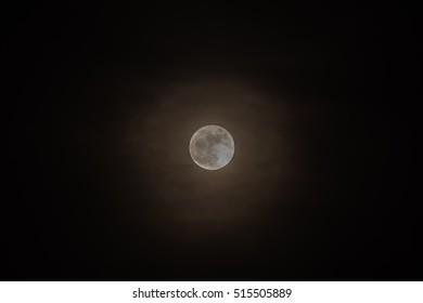 Rare full moon not seen since 1948 through a veil of high clouds