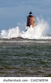 Rare high tide causes giant waves to break around the stone tower of Whaleback lighthouse in Maine.