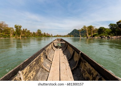 Rare irawaddy dolphins boat trip from Khongyai beach on Don Khone island in south Laos. Landscape taken from boat on four thousands islands on Mekhong river in south east asia during summer.