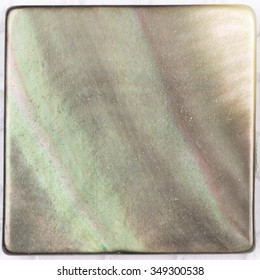 rare natural pearl black pearl with iridescent tints and inclusions in the form of a square plate for mosaic