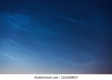 Rare noctilucent clouds or night shining clouds, may be used as background