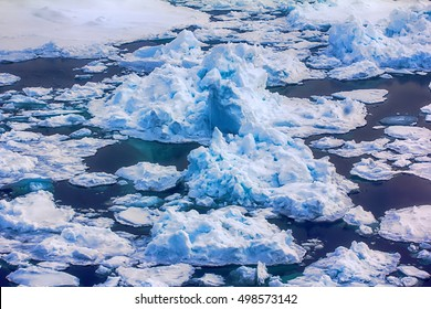 Rare now on North pole perennial ice broken by nuclear icebreaker. Broken ice behind (channel)
