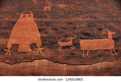 A rare owl and big horned sheep, part of a petroglyph panel off Kane Creek Boulevard in Moab, Utah, USA. This canyon has archaic, fremont, anasazi (ancestral puebloan) rock art.