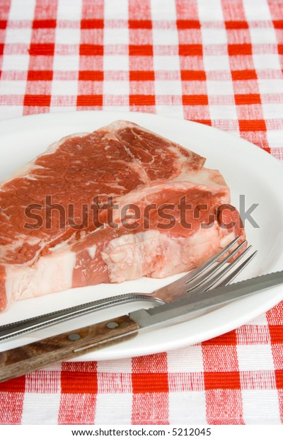 For the rare steak lover. Actually it's a slab of raw T-bone steak.