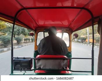rare view Close up shot of indian auto rickshaw or rickshaw driver or tuktuk driver