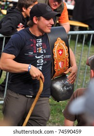 RARON, SWITZERLAND - APRIL 3: The first prize, a cow bell,  for Lolita at the cow fighting championships. April 3, 2010 in Raron, Switzerland