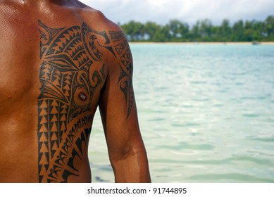 RAROTONGA, COOK ISLANDS,OCTOBER 18 : A Cook Islands man displays his traditional Polynesian tattoos while standing in front of Muri Lagoon on October 18, 2008 in Rarotonga, Cook Islands.