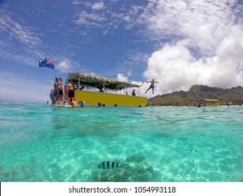 RAROTONGA - DEC 21 2017:Tourists snorkeling and swimming in Rarotonga lagoon. The Cook Islands are world renown as a superb diving destination due to its warm all year-round calm crystal clear waters.