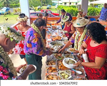 RAROTONGA -  DEC 28 2017:Cook Islanders people eat traditional food.South Pacific islands are banning foreign junk food imports in favour of an all-local organic diet as a way to combat future health