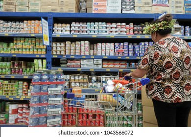 RAROTONGA - JAN 04 2018:Cook Islander woman buying groceries.New Zealand supplying the bulk of the Cook Islands imports and the food imports alone cost many times the value of all Cook Islands export