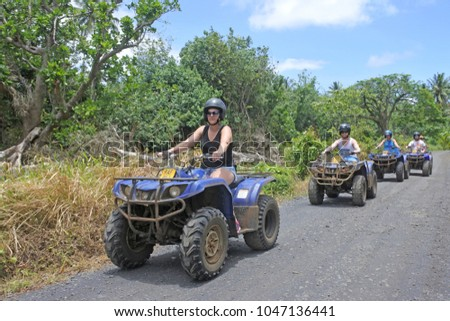 RAROTONGA - JAN 06 2018:Quad bike safari adventure tour in Rarotonga, Cook Islands. Safety has been a major issue with ATVs due to the high number of deaths and injuries associated with them.