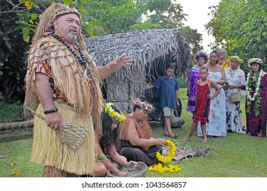 RAROTONGA - JAN 16 2018:Cook Islander tribal chief welcome tourists in a Maori village. About 100,000 visitors travelling to the islands each year, tourism is the country's main industry.