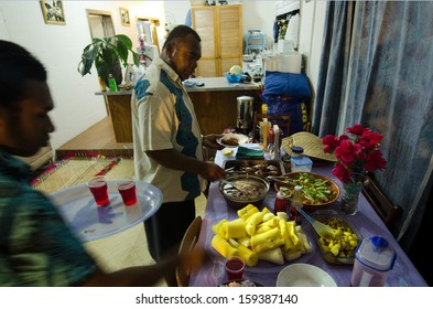 RAROTONGA - SEP 16:Fijian men eats traditional food at home on Sep 16 2013.Fijian people are the major indigenous people of the Fiji Islands since 3,500 years ago.