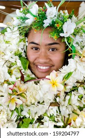 RAROTONGA - SEP 16:Pacific Islander woman covered with flower top on Sep 16 2013.The Cook Islands' main population centers are on the island of Rarotonga (14,153 in 2006).