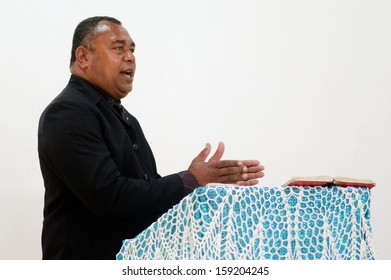 RAROTONGA - SEP 16:Reverent preaching on Sunday service at the Methodist Church of Fiji on Sep 16 2013.94% of Cook Islanders associated themselves with Christianity.