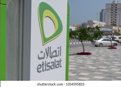 """Ras al Khaimah, RAK/United Arab Emirates - 03/31/2019: Ras al Khaimah Corniche Etisalat Phonebooth on the street in the sun.."""