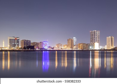 Ras al Khaimah skyline reflecting in the creek. United Arab Emirates, Middle East