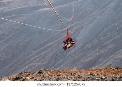 RAS AL KHAIMAH, UAE - JUNE, 2018: The longest zipline in the world from the highest point in the emirates. Jebel Jais.