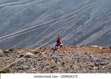 RAS AL KHAIMAH, UAE - JUNE, 2018: The longest zipline in the world from the highest point in the United Arab Emirates. Mountain Jebel Jais.