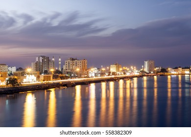 RAS AL KHAIMAH, UAE - NOV 30, 2016: Ras al Khaimah creek and corniche illuminated at night. United Arab Emirates, Middle East