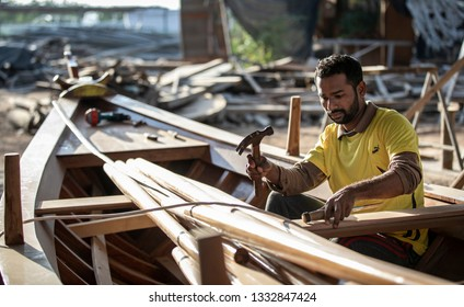 Ras Al Khaimah, United Arab Emirates, 8th March 2019: man working on newly made dhow, the traditional boat of Middle East