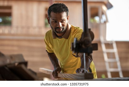 Ras Al Khaimah, United Arab Emirates, 8th March 2019: worker cutting wood at the dhow factory