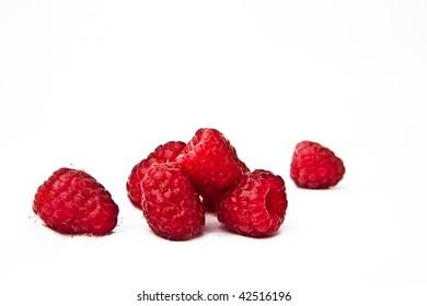 Rasberries on a white background