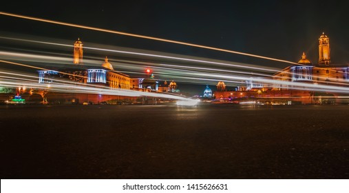 The Rashtrapati Bhavan during night time with light trails.