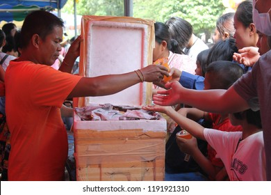 Rasisalai Sisaket, Thailand – September 30, 2018: Many people attended Boon Maha Sangkatarn, where volunteers brought food and drink to the area for free in Wat Ban Wan, Thailand.