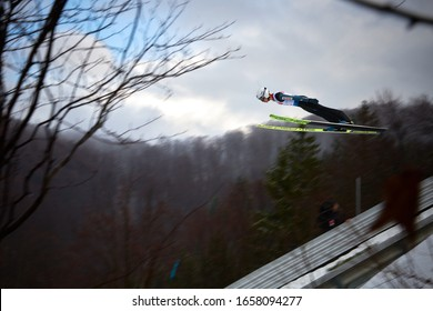 Rasnov, Romania - 20 th-22th February 2020: Unknown ski jumper compets to win the Man World Cup Ski Jumping event in Rasnov, Romania in motion blur, Blurred background