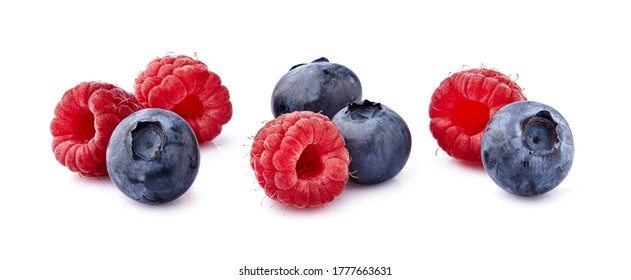 Raspberries  with  blueberries Isolated on White Background. Ripe berries isolated.