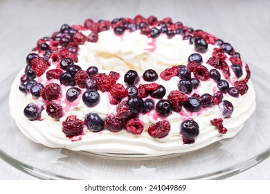 Raspberries and blueberries pie on glass scale