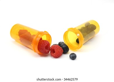 Raspberries and blueberris in pill bottles